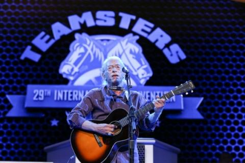 Musician Joel Rafael playing guitar at Teamsters Convention